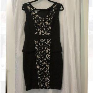 Fitted black dress with plemplem waist